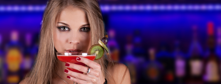 Beautiful girl drinking a cocktail